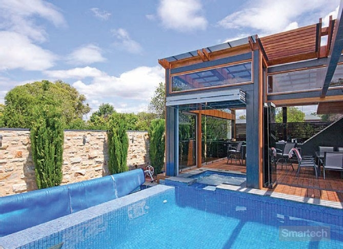smartech folding systems open up the house to the pool