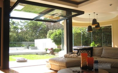 smartech tilt doors joining indoors and outdoors in a home