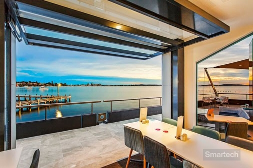 smartech tilt doors in a restaurant with a view